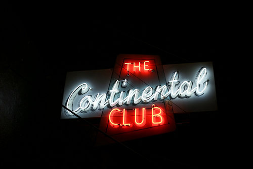 The Continental Club neon sign lit up