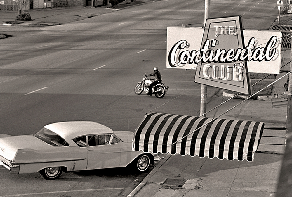 An old black and white photograph of The Continental Club sign