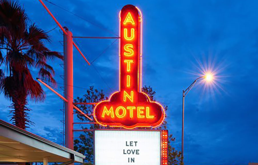The Austin Motel neon sign lit up