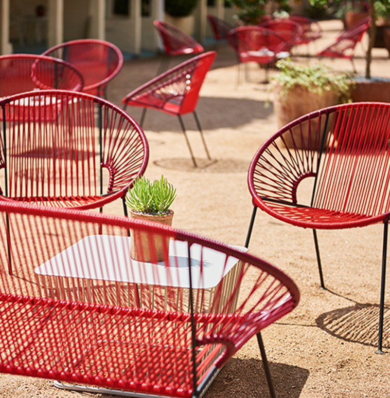 A group of red outdoor chairs