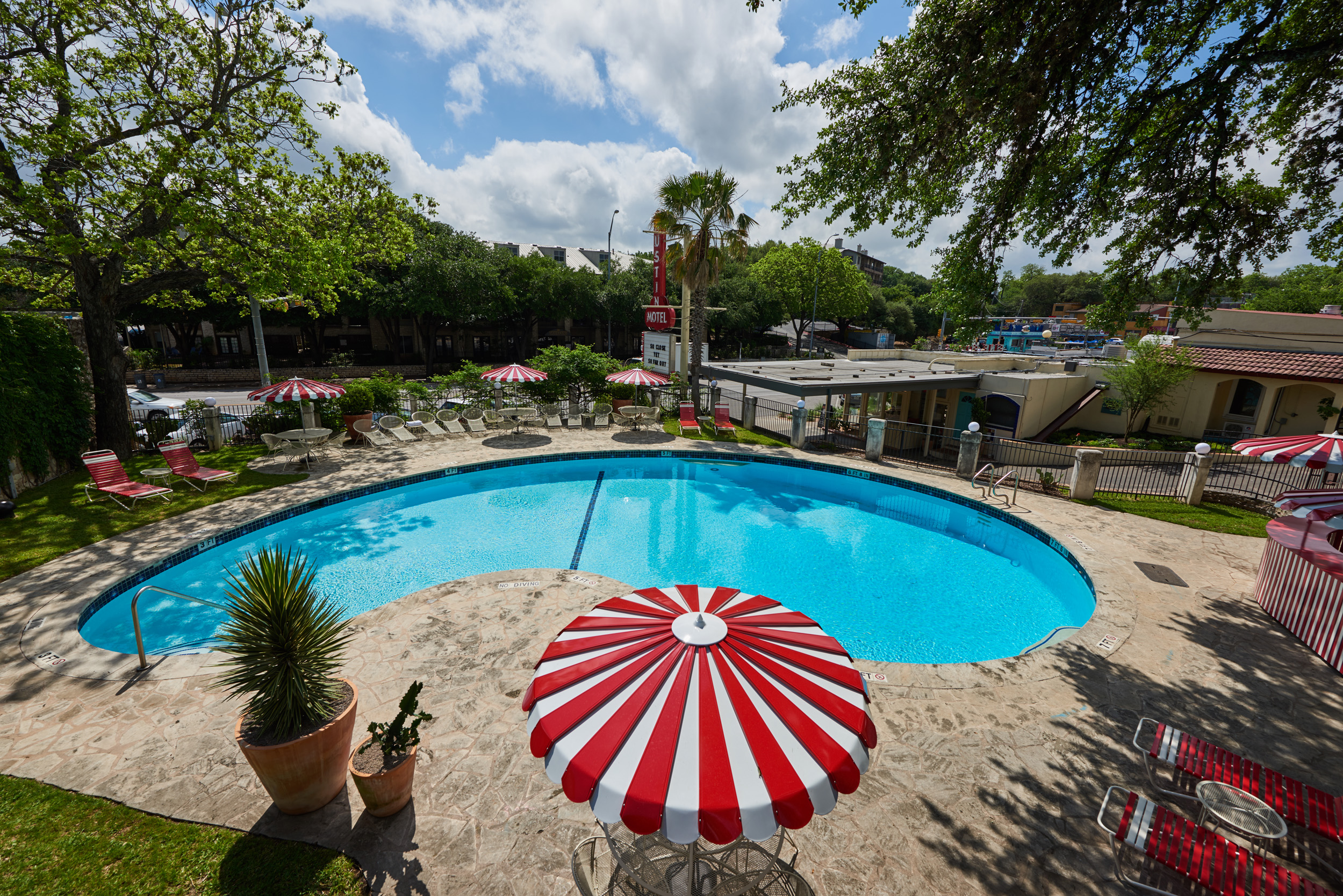 Outdoor pool area at the Austin Motel on a sunny day