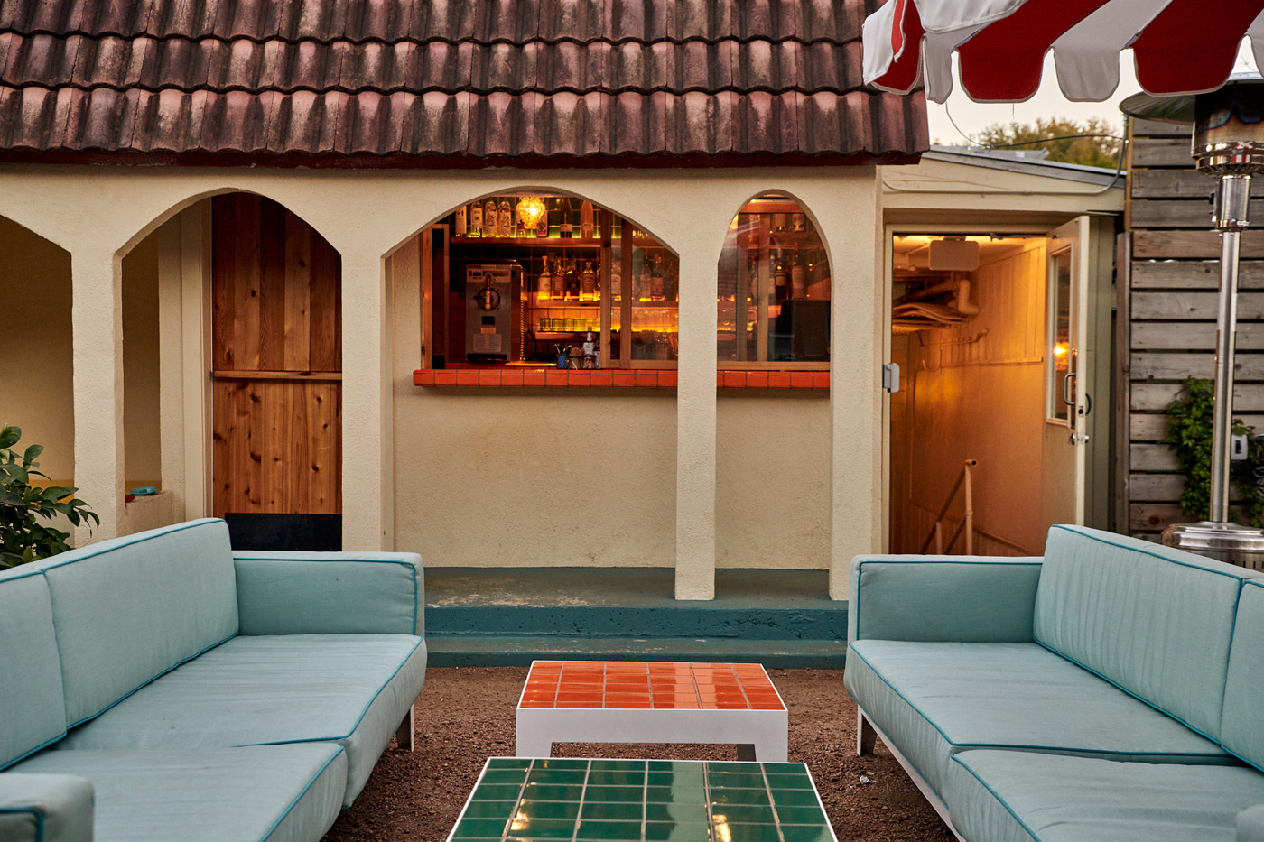 Outdoor lounging area and bar at the Austin Motel